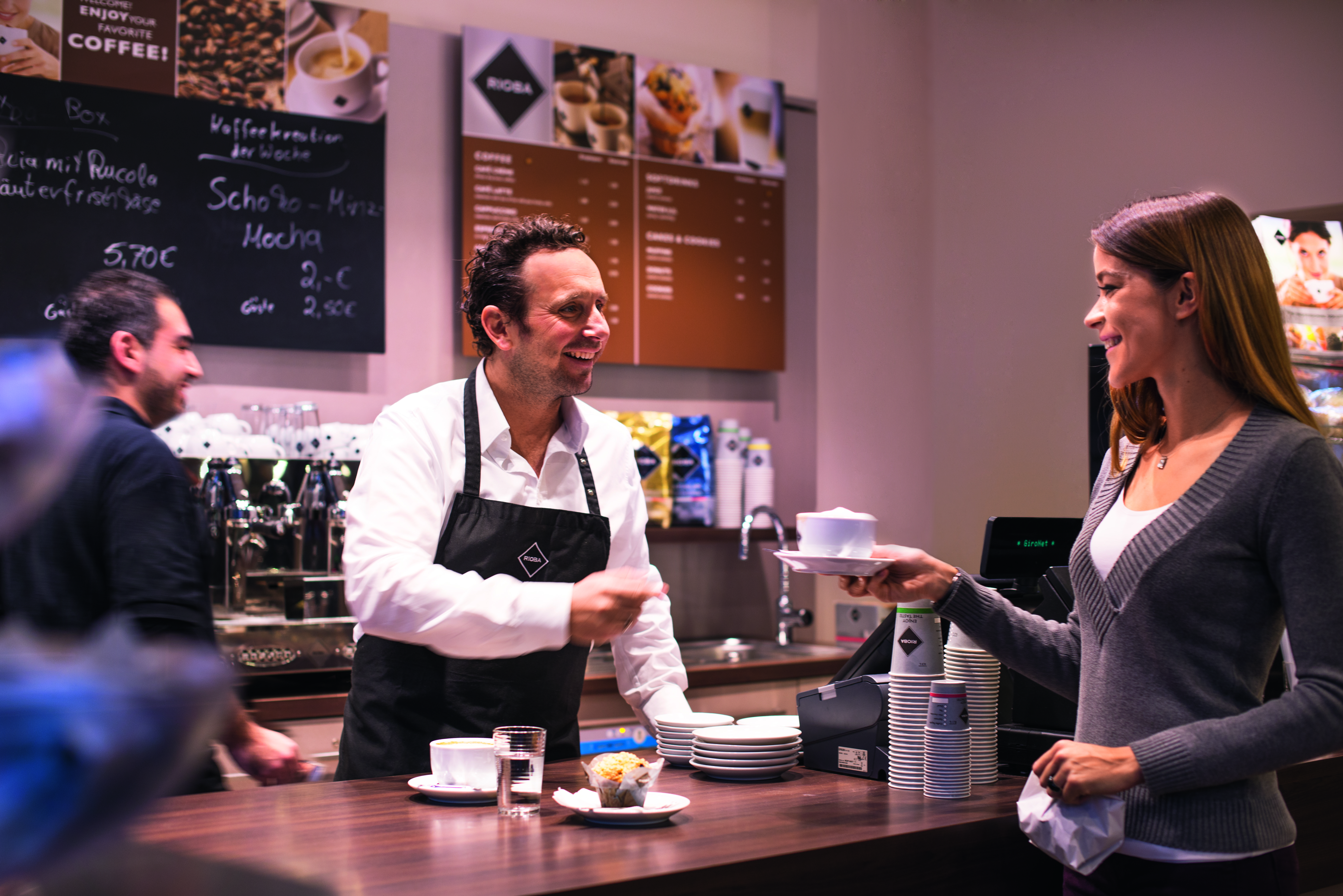 Staff and Customer in a Cafe