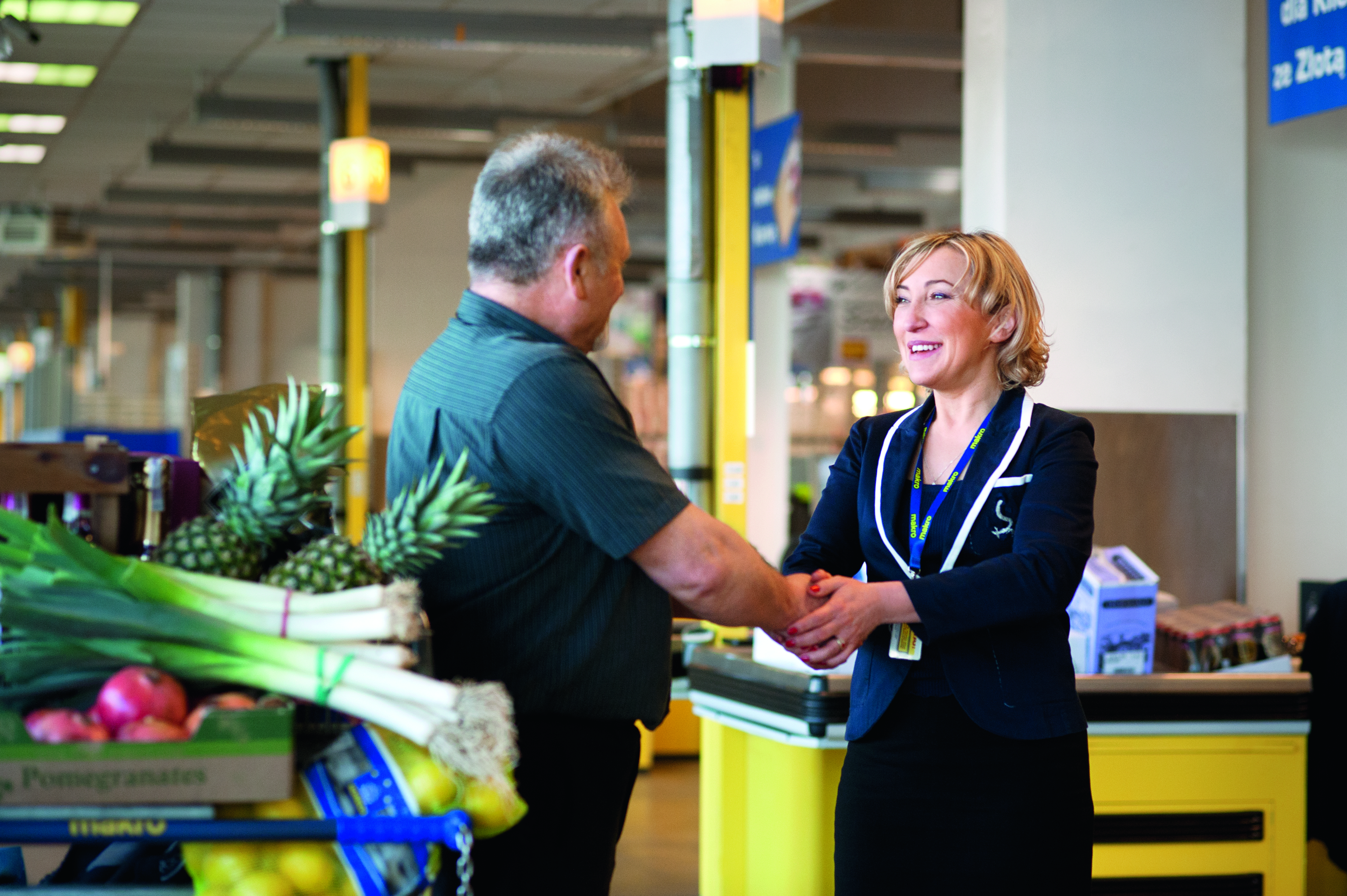 Store Manager shaking Hands with Customer