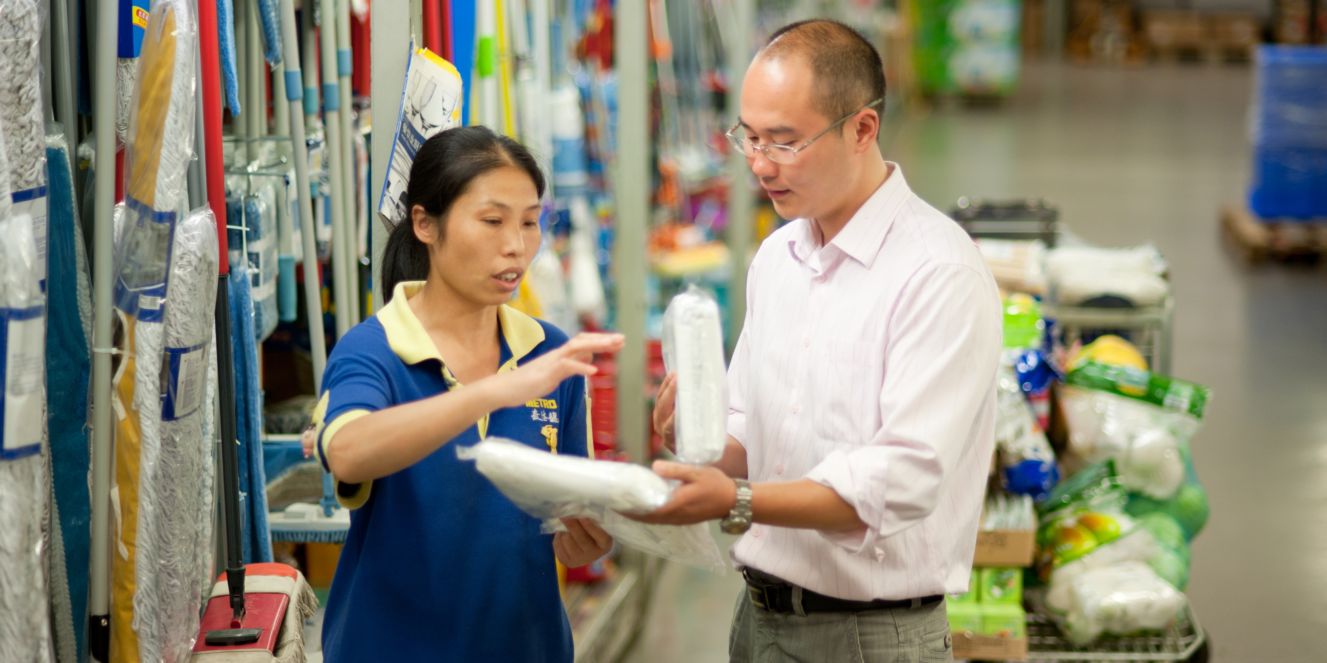 Chinese Employee advising Customer